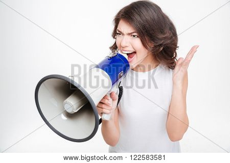 Young woman screaming into megaphone isolated on a white background