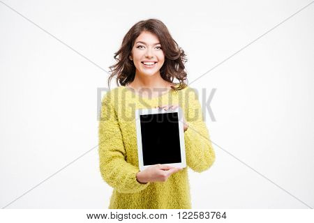Smiling casual woman showing tablet computer isolated on a white background