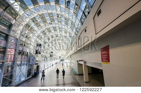 TORONTO CA 29th june 2012. People walk through the glass indoor walkway between Union Station and the CN Tower.