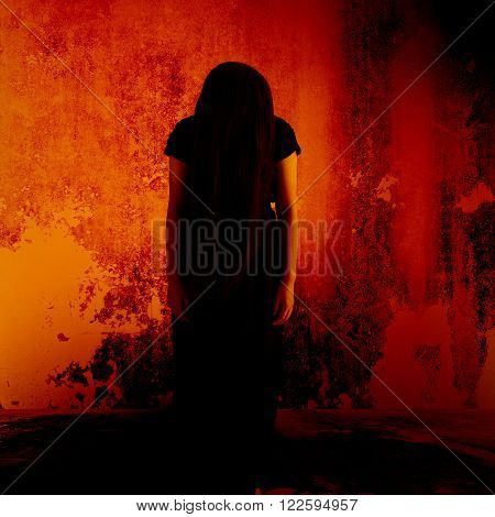Curse of the witch,Mysterious girl in black dress standing in abandon place,Horror background for halloween concept and movie poster project
