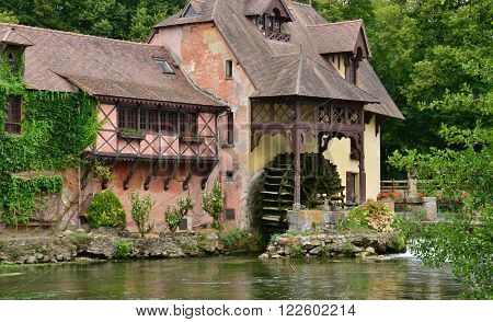 Fourges France - august 13 2015 : the water mill wich is now a gastronomic restaurant called the mill of fourges
