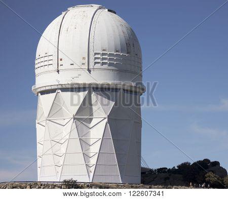 TUCSON, ARIZONA, FEBRUARY 28. Kitt Peak National Observatory on February 28, 2016, near Tucson, Arizona. The giant Mayall 4m telescope dwarfs the tourists at its base at Kitt Peak National Observatory near Tucson Arizona.