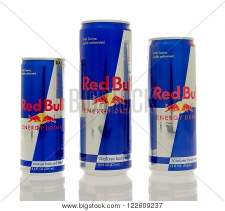 Winneconne WI - 14 March 2016: Three different sizes of Red Bull energy drink.