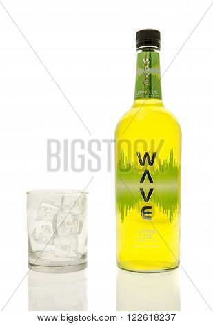 Winneconne WI - 15 March 2016: A bottle of Wave lemon lime vodka with a glass of ice