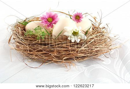 Easter White Eggs In The Nest With Pink And White Flowers