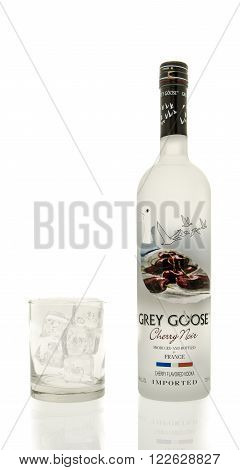 Winneconne WI - 15 March 2016: A bottle of Grey Goose cherry noir vodka with a glass of ice