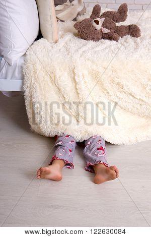 Child Under Bed