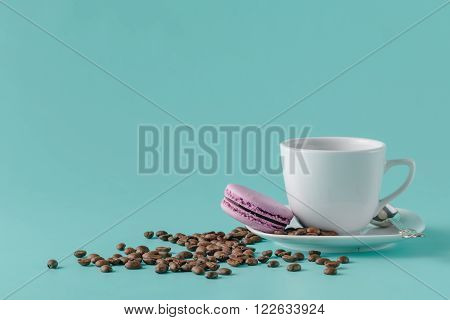 A Cup Of Coffee On A Saucer On A Aquamarine Background