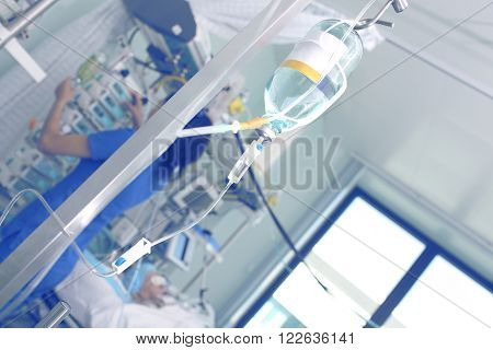 Nurse caring for the patient in intensive care.