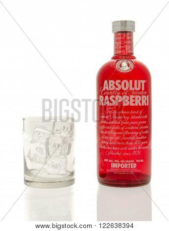 Winneconne, WI - 15 March 2016: A bottle of Absolut raspberri vodka with a glass of ice