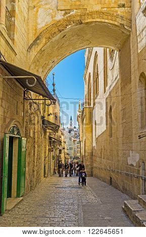 JERUSALEM, ISRAEL - FEBRUARY 16, 2016: The Via Dolorosa is the narrow street inside the walled town, that leads from the Lions' Gate to the Church of the Holy Sepulchre and shows the way of Christ, on February 16 in Jerusalem.