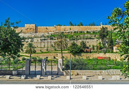 The Kidron Valley and the medieval walls of the old Jerusalem on the background Israel.