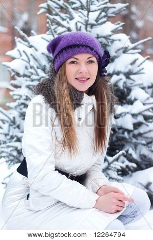 A Young Girl Touched His Hand A Branch Eating; Winter; Snow;