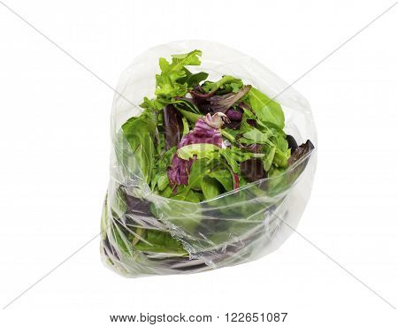 Bag of healthy spring salad on a white background