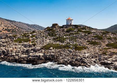Greece. Panormitis. Mill at the entrance to the bay.