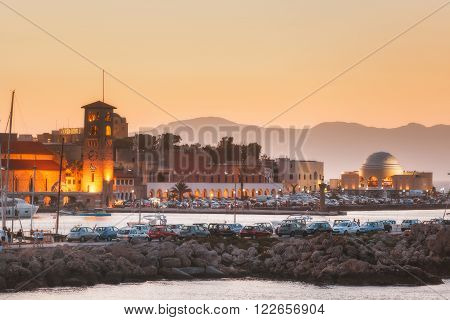 Greece, Rhodes - July 13 Mandraki embankment and port at sunset on July 13, 2014 in Rhodes, Greece