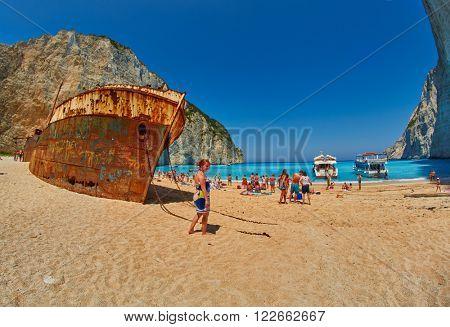 ZANTE ISLAND, GREECE - CIRCA JUNE 2015: Tourists in Navagio Bay with Pirate's Shipwreck