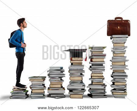 Boy climbing the stairs made of books