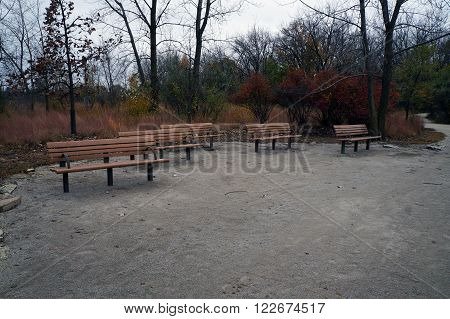 Visitors to the Lake Renwick Heron Rookery Nature Preserve, in Plainfield, Illinois, may sit and rest on a bench.