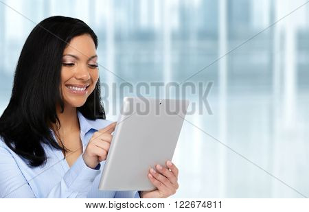 Asian business woman with tablet computer.