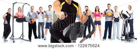 Man exercising on elliptical trainer.