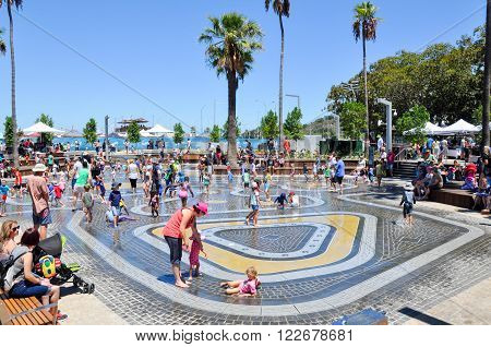 PERTH,WA,AUSTRALIA-FEBRUARY 13,2016: Families enjoying the water park at the Elizabeth Quay development in Perth, Western Australia.