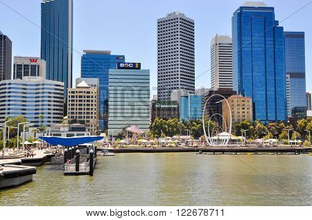 PERTH,WA,AUSTRALIA-FEBRUARY 13,2016: The Elizabeth Quay artificial inlet with tourists, Spanda sculpture, and cityscape behind the Swan River in Perth, Western Australia.