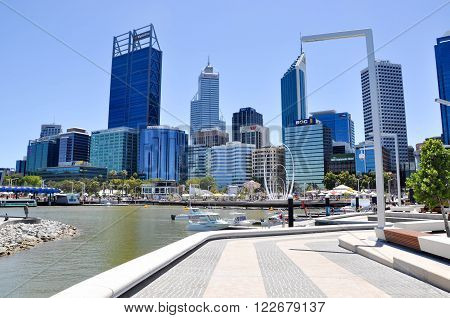 PERTH,WA,AUSTRALIA-FEBRUARY 13,2016: The Elizabeth Quay artificial inlet on the Swan River in Perth, Western Australia with tourists, boat docks and the urban cityscape.