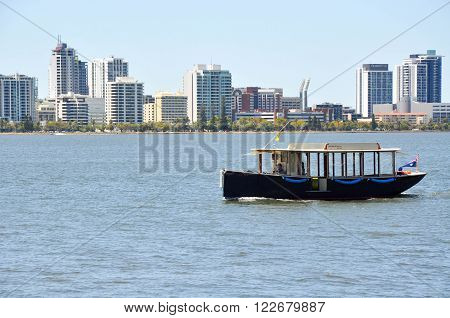 PERTH,WA,AUSTRALIA-FEBRUARY 13,2016: Ferry transport on the Swan River with city buildings in Perth, Western Australia.
