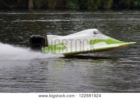 A formula 1 race boat racing on the water