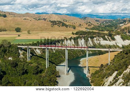 Stream train cross over one of New Zealand tallest trestle bridge over the Rangitikei river.