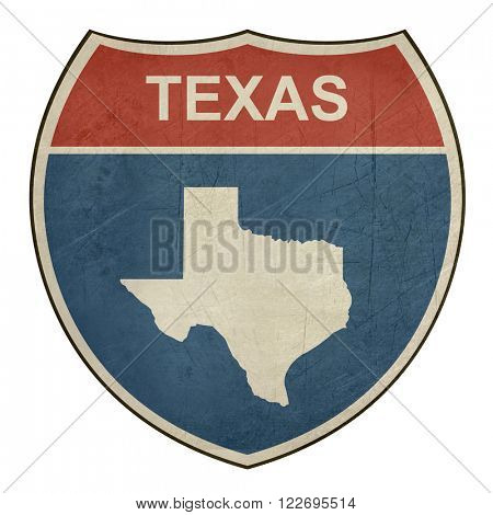 Grunge Texas American interstate highway road shield isolated on a white background.
