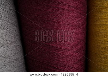 Grey, Maroon, And Yellow Sewing Thread Swatch