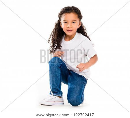smiling little cute girl knelted on one knee