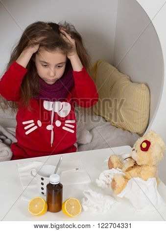 Fever, cold and flu concepts. Sick girl looking fed up with her illness. Gilr sittin on bed and combing her hair. Medicines.