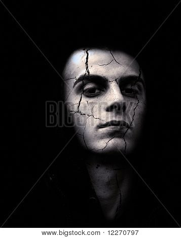 portrait of spooky looking man with cracked skin poster
