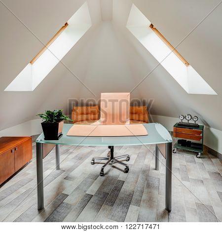 Photo of minimalist study room on attic