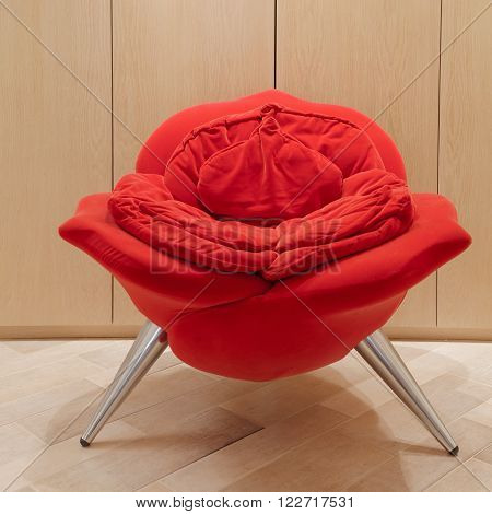 Vertical image of avant-garde armchair in shape of rose