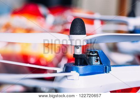 Quadrocopters Engine And Propeller Close To The Blurred Background