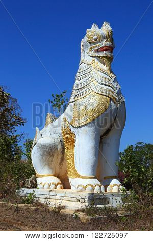 Ancient statue of lion guardian in Shwe Inn Thein Paya temple complex near Inle Lake in central Myanmar (Burma)