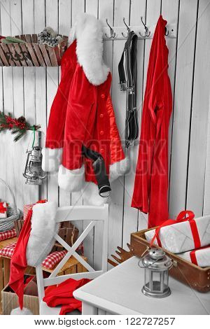 Interior of Santa Claus home on white wooden wall