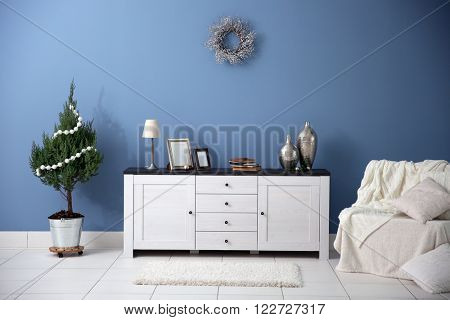 Modern interior with decorated Christmas tree