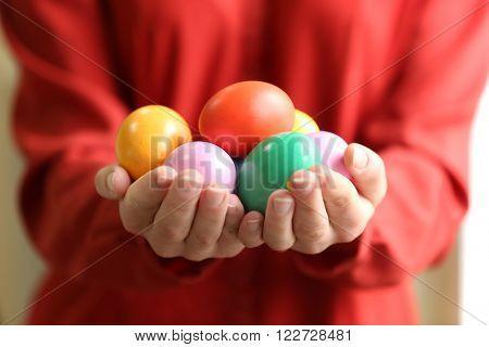 Female hands holding Easter eggs