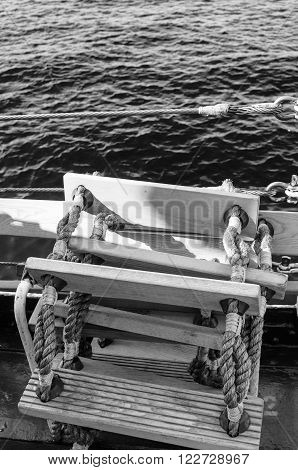 Wooden gangway on ropes a close up