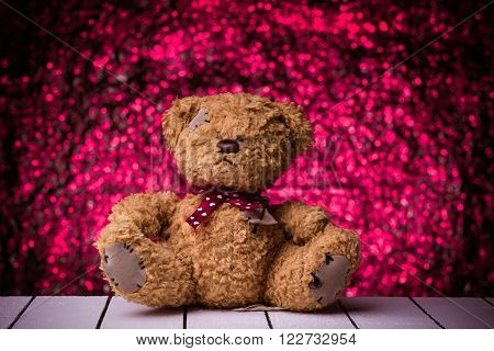 Teddy Bear toy alone on  wooden floor with nice bokeh background