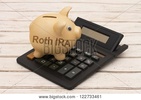 Saving for your retirement A golden piggy bank and calculator on a wood background with text Roth IRA