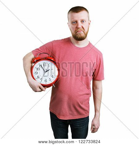 Unhappy man with an alarm clock in hands