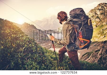 Man Traveler with backpack mountaineering Travel Lifestyle concept lake and mountains on background Summer expedition vacations outdoor