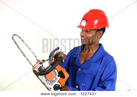 African Man With Chainsaw