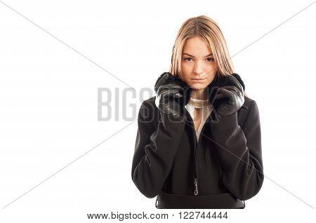 Portrait Of A Young Female Model Wearing Black Coat